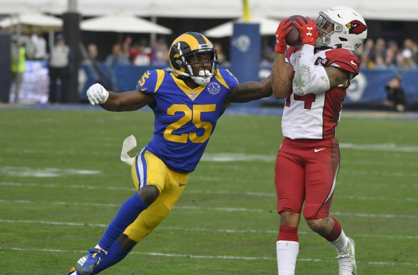 LOS ANGELES, CA - DECEMBER 29: Damiere Byrd #14 of the Arizona Cardinals catches a ball over David Long #25 of the Los Angeles Rams in the second quarter at Los Angeles Memorial Coliseum on December 29, 2019 in Los Angeles, California. (Photo by John McCoy/Getty Images)
