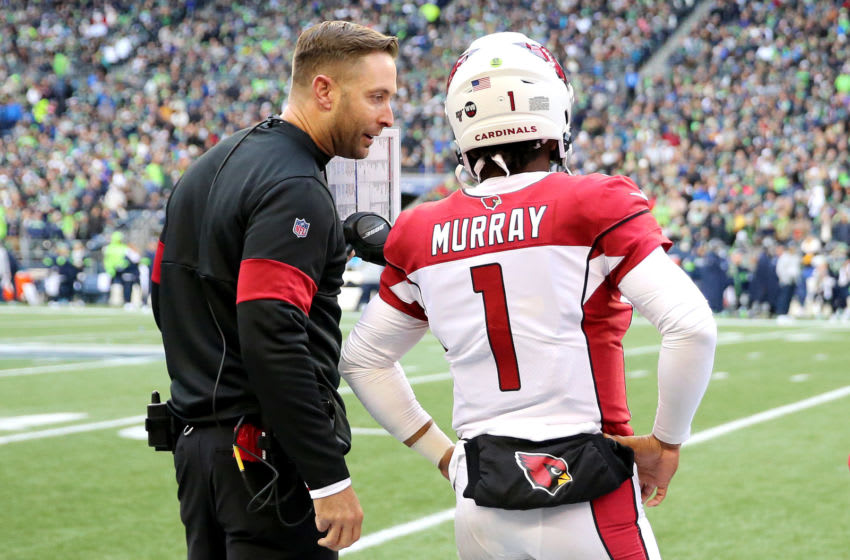 SEATTLE, WASHINGTON - DECEMBER 22: Head coach Kliff Kingsbury of the Arizona Cardinals and quarterback Kyler Murray #1 talk on the sidelines during the game against the Seattle Seahawks at CenturyLink Field on December 22, 2019 in Seattle, Washington. (Photo by Abbie Parr/Getty Images)