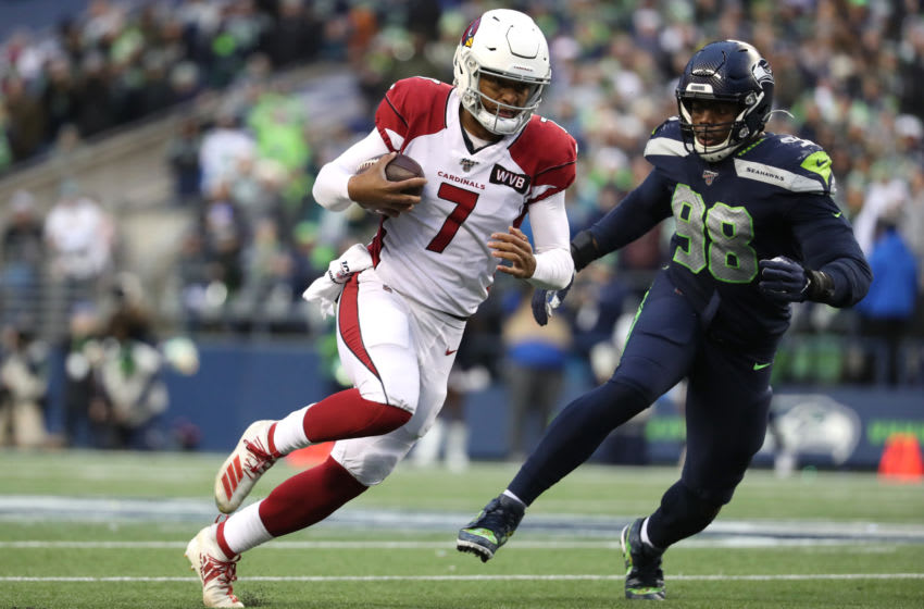 SEATTLE, WASHINGTON - DECEMBER 22: Brett Hundley #7 of the Arizona Cardinals runs with the ball in the third quarter against Rasheem Green #98 of the Seattle Seahawks during their game at CenturyLink Field on December 22, 2019 in Seattle, Washington. (Photo by Abbie Parr/Getty Images)