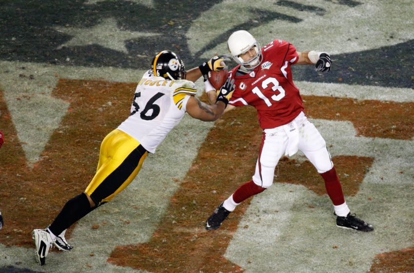TAMPA, FL - FEBRUARY 01: Quarterback Kurt Warner #13 of the Arizona Cardinals fumbles the ball with :15 seconds to play as he is sacked by LaMarr Woodley #56 of the Pittsburgh Steelers during Super Bowl XLIII on February 1, 2009 at Raymond James Stadium in Tampa, Florida. Steelers won 27-23. (Photo by Doug Benc/Getty Images)