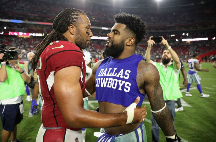 GLENDALE, AZ - SEPTEMBER 25: Wide receiver Larry Fitzgerald #11 of the Arizona Cardinals and running back Ezekiel Elliott #21 of the Dallas Cowboys embrace after the NFL game at the University of Phoenix Stadium on September 25, 2017 in Glendale, Arizona. Dallas won 28-17. (Photo by Christian Petersen/Getty Images)