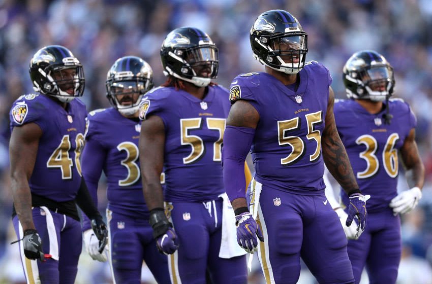 BALTIMORE, MARYLAND - NOVEMBER 25: Outside linebacker Terrell Suggs #55 of the Baltimore Ravens looks on with teammates against the Oakland Raiders at M&T Bank Stadium on November 25, 2018 in Baltimore, Maryland. (Photo by Patrick Smith/Getty Images)
