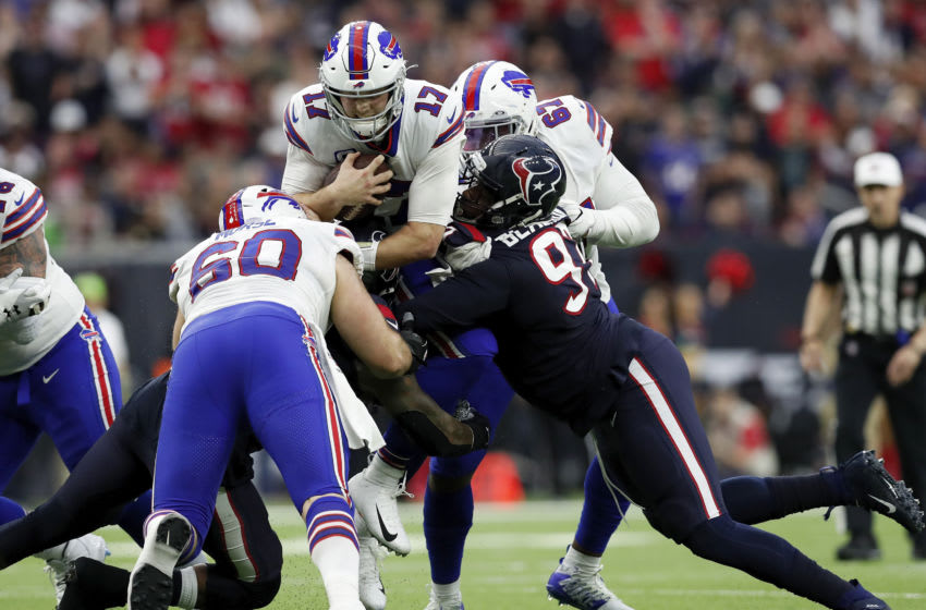 HOUSTON, TEXAS - JANUARY 04: Josh Allen #17 of the Buffalo Bills is tackled by Angelo Blackson #97 of the Houston Texans and Benardrick McKinney #55 in the first half of the AFC Wild Card Playoff game at NRG Stadium on January 04, 2020 in Houston, Texas. (Photo by Tim Warner/Getty Images)