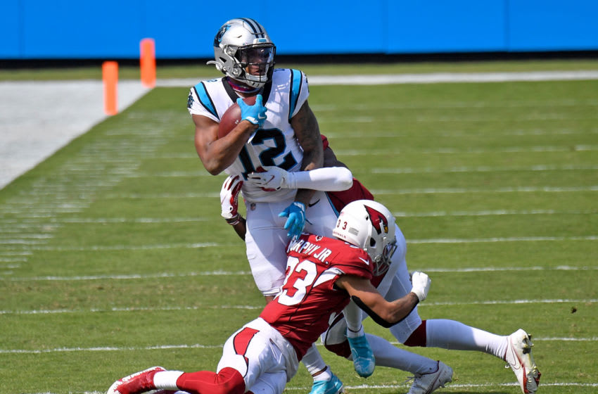 CHARLOTTE, NORTH CAROLINA - OCTOBER 04: Deionte Thompson #22 and Budda Baker #32 of the Arizona Cardinals tackle D.J. Moore #12 of the Carolina Panthers during the second quarter of their game at Bank of America Stadium on October 04, 2020 in Charlotte, North Carolina. (Photo by Grant Halverson/Getty Images)