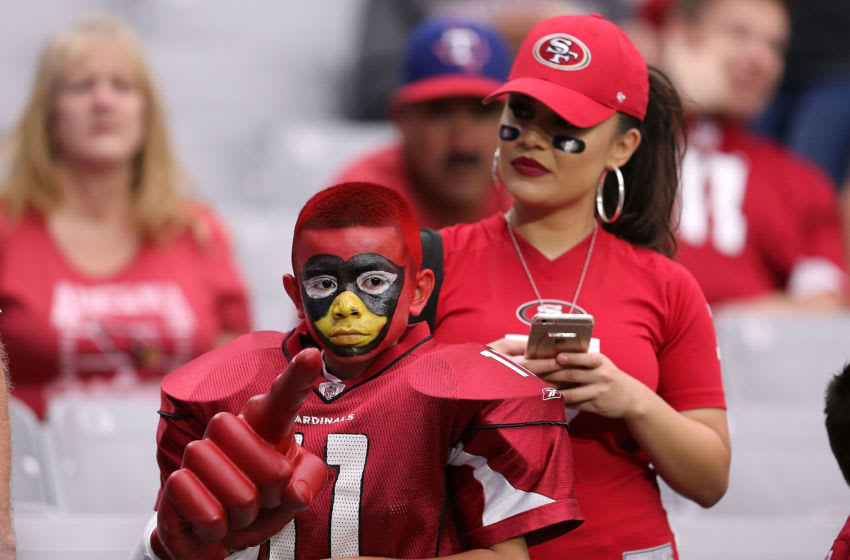 GLENDALE, AZ - NOVEMBER 13: A young Arizona Cardinals fan watches warmups prior to the start of the NFL football game against the San Francisco 49ers at University of Phoenix Stadium on November 13, 2016 in Glendale, Arizona. (Photo by Chris Coduto/Getty Images)