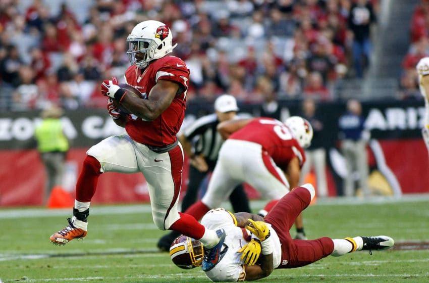 GLENDALE, AZ - DECEMBER 04: Running back David Johnson #31 of the Arizona Cardinals steps out of the tackle by Bashaud Breeland #26 of the Washington Redskins during the second quarter of a game at University of Phoenix Stadium on December 4, 2016 in Glendale, Arizona. The Cardinals defeated the Redskins 31-23. (Photo by Ralph Freso/Getty Images)