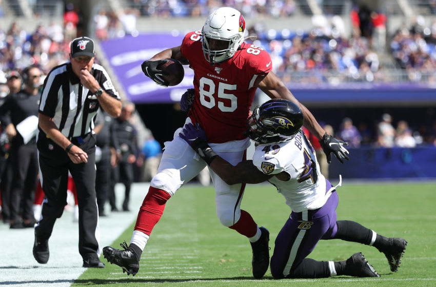 BALTIMORE, MARYLAND - SEPTEMBER 15: Tight end Charles Clay #85 of the Arizona Cardinals is tackled by linebacker Chris Board #49 of the Baltimore Ravens during the second half at M&T Bank Stadium on September 15, 2019 in Baltimore, Maryland. (Photo by Patrick Smith/Getty Images)