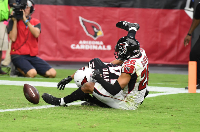 GLENDALE, ARIZONA - OCTOBER 13: Damiere Byrd #14 of the Arizona Cardinals looses the ball while being tackled by Isaiah Oliver #26 of the Atlanta Falcons during the first half at State Farm Stadium on October 13, 2019 in Glendale, Arizona. The ball rolled into the end zone but was ruled down by contact. (Photo by Norm Hall/Getty Images)