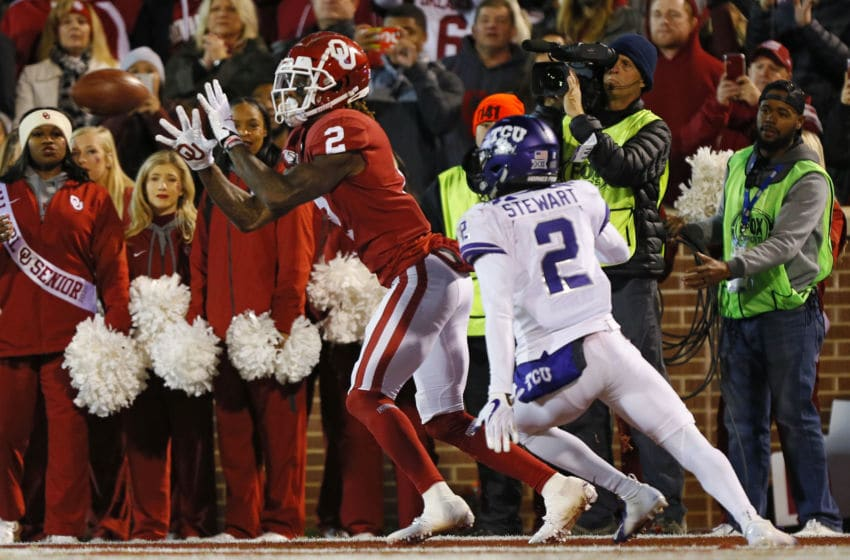 NORMAN, OK - NOVEMBER 23: Wide receiver CeeDee Lamb #2 of the Oklahoma Sooners catches a 5-yard pass against for a touchdown against cornerback Kee'Yon Stewart #2 of the TCU Horned Frogs in the second quarter on November 23, 2019 at Gaylord Family Oklahoma Memorial Stadium in Norman, Oklahoma. (Photo by Brian Bahr/Getty Images)