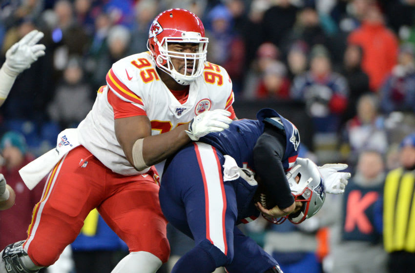 FOXBOROUGH, MASSACHUSETTS - DECEMBER 08: Chris Jones #95 of the Kansas City Chiefs sacks Tom Brady #12 of the New England Patriots during the third quarter in the game at Gillette Stadium on December 08, 2019 in Foxborough, Massachusetts. (Photo by Kathryn Riley/Getty Images)
