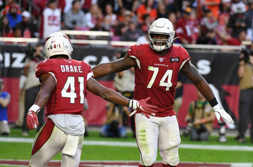 GLENDALE, ARIZONA - DECEMBER 15: Kenyan Drake #41 of the Arizona Cardinals celebrates with DJ Humphries #74 after scoring his third touchdown of the game against the Cleveland Browns during the second half at State Farm Stadium on December 15, 2019 in Glendale, Arizona. Cardinals won 38-24. (Photo by Norm Hall/Getty Images)