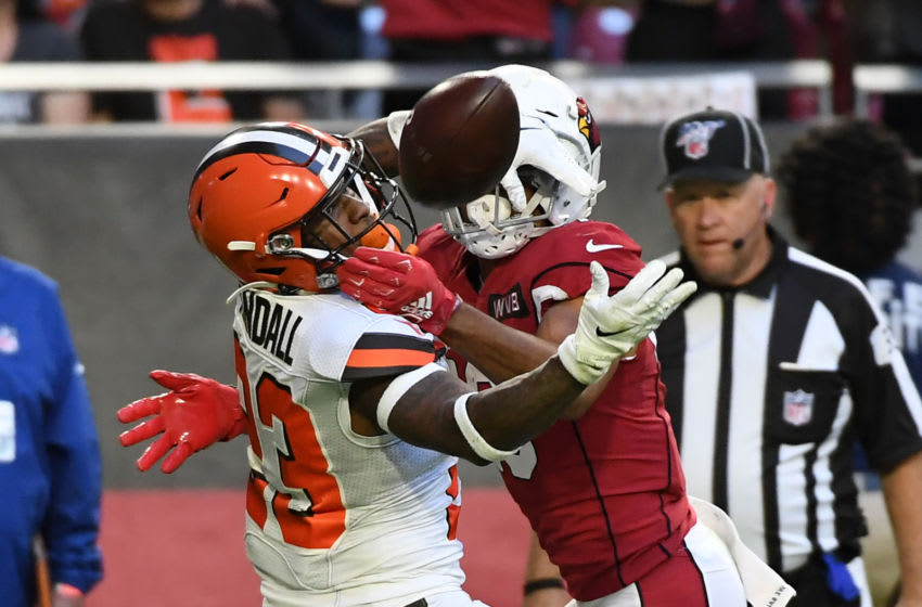 GLENDALE, ARIZONA - DECEMBER 15: Damarious Randall #23 of the Cleveland Browns battles for the ball with Christian Kirk #13 of the Arizona Cardinals during the second half at State Farm Stadium on December 15, 2019 in Glendale, Arizona. Cardinals won 38-24. (Photo by Norm Hall/Getty Images)