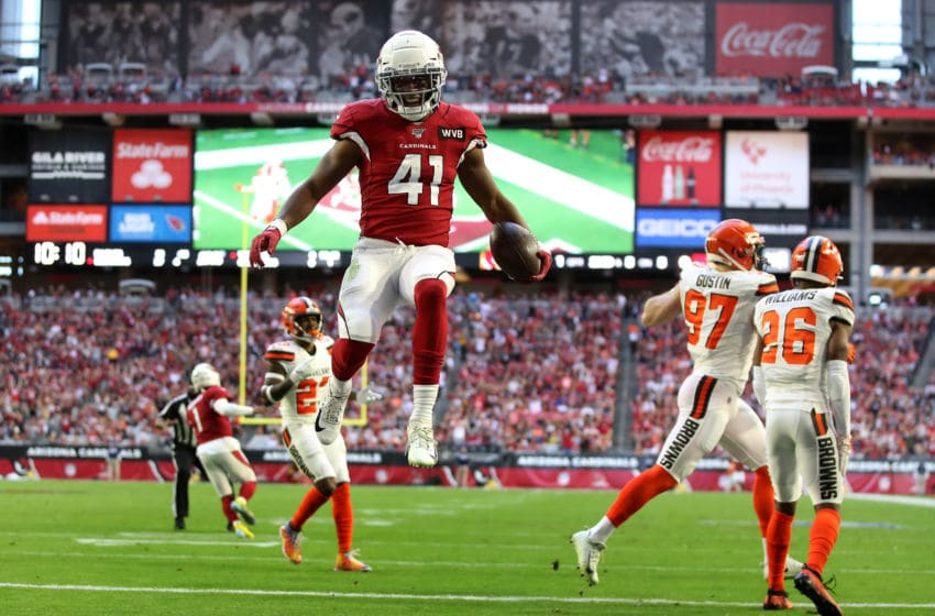 GLENDALE, ARIZONA - DECEMBER 15: Running back Kenyan Drake #41 of the Arizona Cardinals jumps into the endzone to score on a five yard rushing touchdown against the Cleveland Browns during the first half of the NFL game at State Farm Stadium on December 15, 2019 in Glendale, Arizona. The Cardinals defeated the Browns 38-24. (Photo by Christian Petersen/Getty Images)