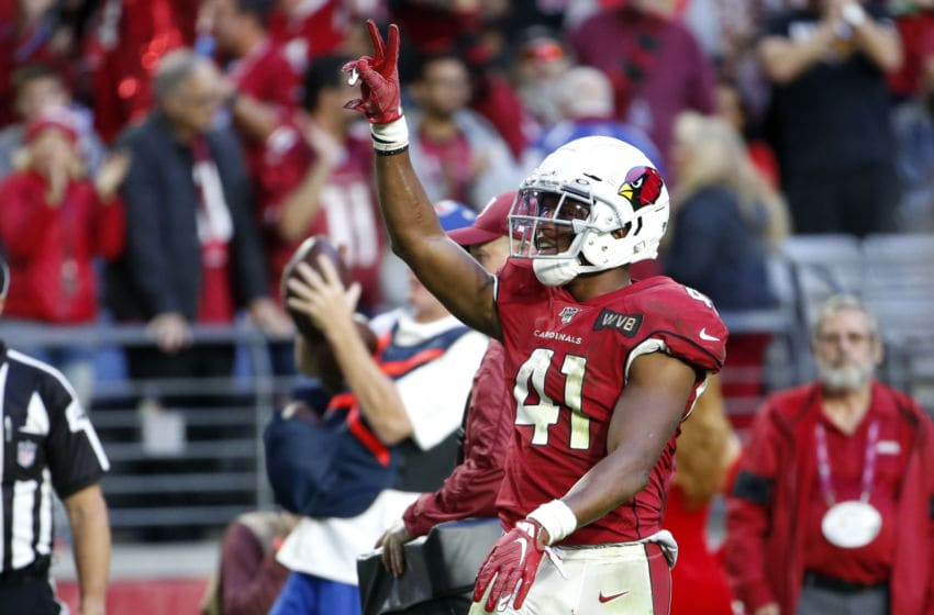 GLENDALE, ARIZONA - DECEMBER 15: Running back Kenyan Drake #41 of the Arizona Cardinals gestures to the crowd after scoring a touchdown against the Cleveland Browns during the second half of the NFL football game at State Farm Stadium on December 15, 2019 in Glendale, Arizona. (Photo by Ralph Freso/Getty Images)