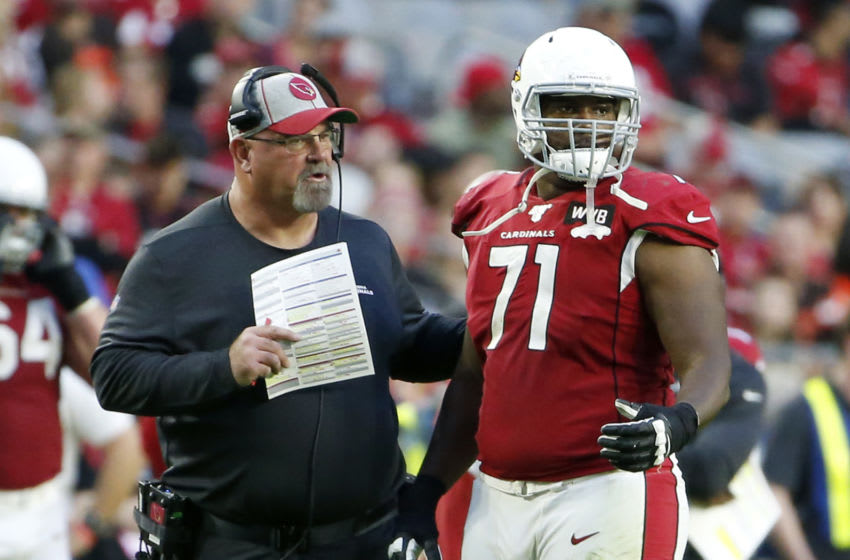 GLENDALE, ARIZONA - DECEMBER 15: Offensive lineman Justin Murray #71 of the Arizona Cardinals with offensive line coach Sean Kugler during the second half of the NFL football game against the Cleveland Browns at State Farm Stadium on December 15, 2019 in Glendale, Arizona. (Photo by Ralph Freso/Getty Images)