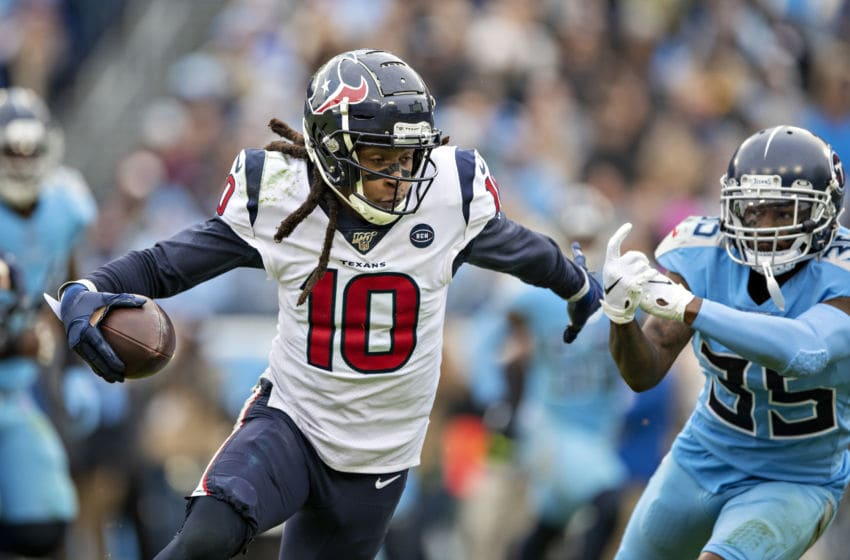 NASHVILLE, TN - DECEMBER 15: DeAndre Hopkins #10 of the Houston Texans runs the ball after catching a pass during a game against the Tennessee Titans at Nissan Stadium on December 15, 2019 in Nashville, Tennessee. The Texans defeated the Titans 24-21. (Photo by Wesley Hitt/Getty Images)