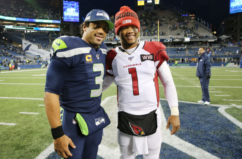 SEATTLE, WASHINGTON - DECEMBER 22: Russell Wilson #3 of the Seattle Seahawks and Kyler Murray #1 of the Arizona Cardinals pose for a photo after the Arizona Cardinals defeated the Seattle Seahawks 27-13 during their game at CenturyLink Field on December 22, 2019 in Seattle, Washington. (Photo by Abbie Parr/Getty Images)