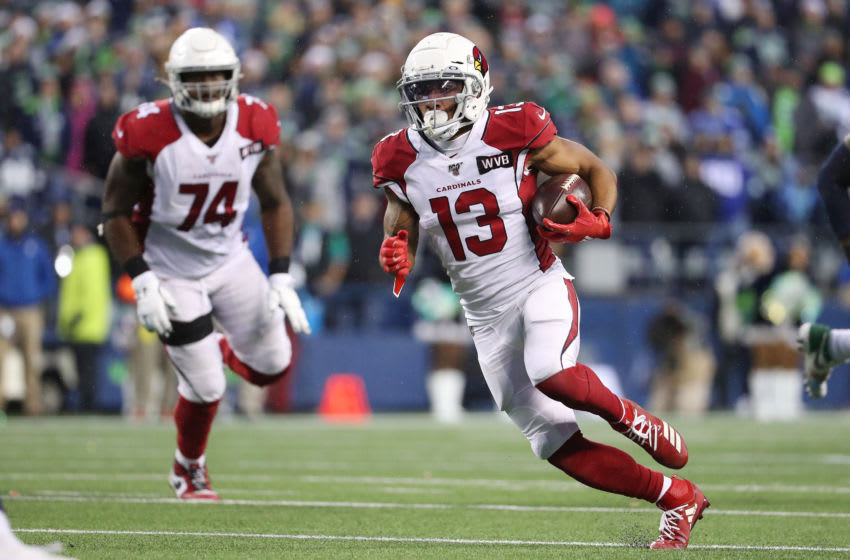 SEATTLE, WASHINGTON - DECEMBER 22: Christian Kirk #13 of the Arizona Cardinals runs with the ball against the Seattle Seahawks in the fourth quarter during their game at CenturyLink Field on December 22, 2019 in Seattle, Washington. (Photo by Abbie Parr/Getty Images)