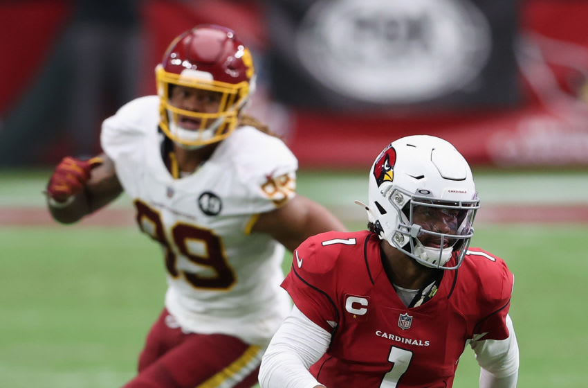 GLENDALE, ARIZONA - SEPTEMBER 20: Quarterback Kyler Murray #1 of the Arizona Cardinals scrambles with the football past defensive end Chase Young #99 of the Washington Football Team during the first half of the NFL game at State Farm Stadium on September 20, 2020 in Glendale, Arizona. The Cardinals defeated the Washington Football Team 30-15. (Photo by Christian Petersen/Getty Images)