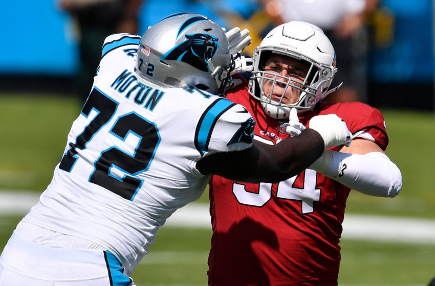 CHARLOTTE, NORTH CAROLINA - OCTOBER 04: Taylor Moton #72 of the Carolina Panthers blocks Zach Allen #94 of the Arizona Cardinals during the first quarter of their game at Bank of America Stadium on October 04, 2020 in Charlotte, North Carolina. (Photo by Grant Halverson/Getty Images)