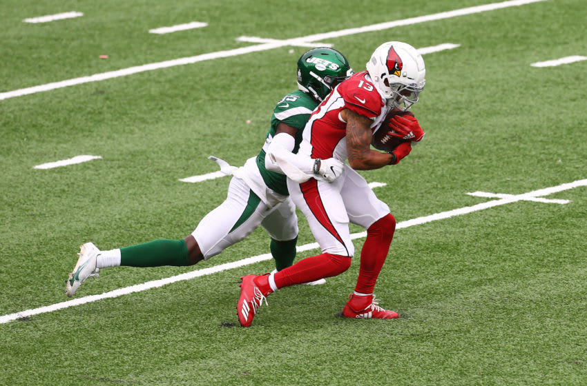 EAST RUTHERFORD, NEW JERSEY - OCTOBER 11: Christian Kirk #13 of the Arizona Cardinals is tackled by Pierre Desir #35 of the New York Jets after making a catch at MetLife Stadium on October 11, 2020 in East Rutherford, New Jersey. Arizona Cardinals defeated the New York Jets 30-10. (Photo by Mike Stobe/Getty Images)