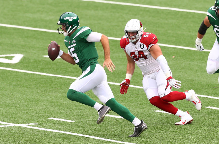 EAST RUTHERFORD, NEW JERSEY - OCTOBER 11: Joe Flacco #5 of the New York Jets scrambles out of the pocket as Zach Allen #94 of the Arizona Cardinals pursues at MetLife Stadium on October 11, 2020 in East Rutherford, New Jersey. Arizona Cardinals defeated the New York Jets 30-10. (Photo by Mike Stobe/Getty Images)
