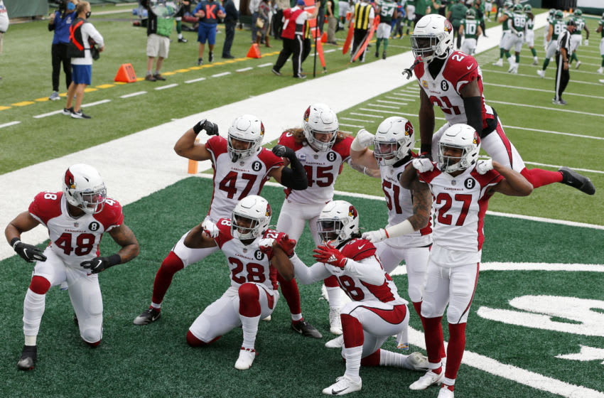 EAST RUTHERFORD, NEW JERSEY - OCTOBER 11: (NEW YORK DAILIES OUT) Members of the Arizona Cardinals celebrate after a play against the New York Jets at MetLife Stadium on October 11, 2020 in East Rutherford, New Jersey. The Cardinals defeated the Jets 30-10. (Photo by Jim McIsaac/Getty Images)