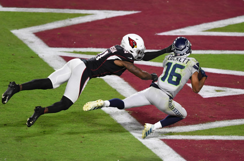 GLENDALE, ARIZONA - OCTOBER 25: Tyler Lockett #16 of the Seattle Seahawks makes a diving catch for a touchdown while being defended by Patrick Peterson #21 of the Arizona Cardinals during the second quarter at State Farm Stadium on October 25, 2020 in Glendale, Arizona. (Photo by Norm Hall/Getty Images)