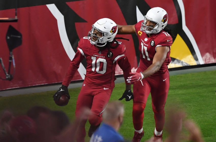 GLENDALE, ARIZONA - NOVEMBER 15: Wide receiver DeAndre Hopkins #10 of the Arizona Cardinals celebrates with wide receiver Larry Fitzgerald #11 after Hopkins caught the game-winning touchdown pass during the second half against the Buffalo Bills at State Farm Stadium on November 15, 2020 in Glendale, Arizona. (Photo by Norm Hall/Getty Images)