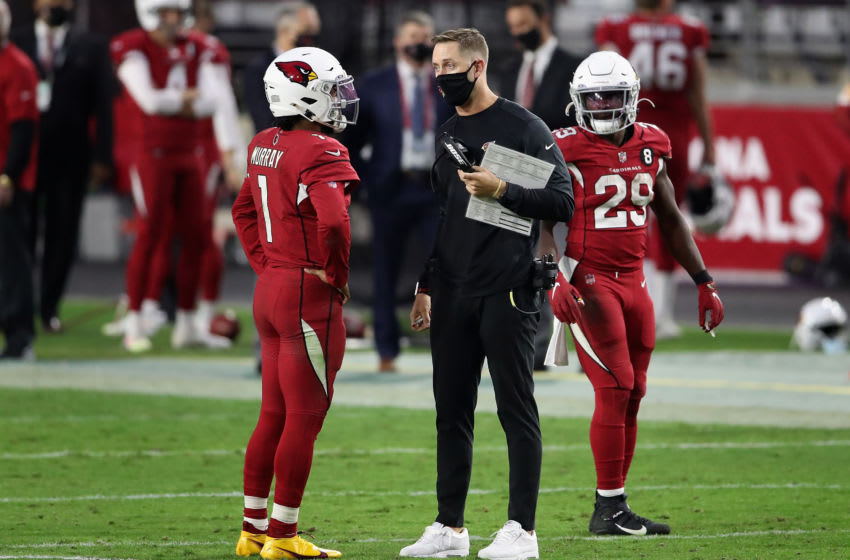 GLENDALE, ARIZONA - NOVEMBER 15: Head coach Kliff Kingsbury of the Arizona Cardinals talks with quarterback Kyler Murray #1 during a second half time-out during the NFL game against the Buffalo Bills at State Farm Stadium on November 15, 2020 in Glendale, Arizona. The Cardinals defeated the Bills 32-30. (Photo by Christian Petersen/Getty Images)