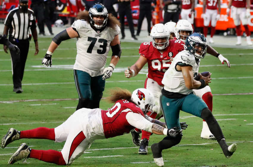 GLENDALE, ARIZONA - DECEMBER 20: Quarterback Jalen Hurts #2 of the Philadelphia Eagles scrambles with the football past Nose tackle Domata Peko Sr. #96 of the Arizona Cardinals during the NFL game at State Farm Stadium on December 20, 2020 in Glendale, Arizona. The Cardinals defeated the Eagles 33-26. (Photo by Christian Petersen/Getty Images)