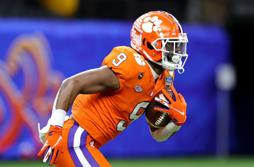 NEW ORLEANS, LOUISIANA - JANUARY 01: Travis Etienne #9 of the Clemson Tigers receives the opening kickoff against the Ohio State Buckeyes in the first quarter during the College Football Playoff semifinal game at the Allstate Sugar Bowl at Mercedes-Benz Superdome on January 01, 2021 in New Orleans, Louisiana. (Photo by Kevin C. Cox/Getty Images)