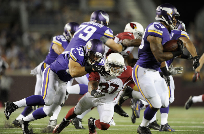 MINNEAPOLIS, MN - AUGUST 16: Zac Kerin #59 of the Minnesota Vikings tackles Anthony Walters #37 of the Arizona Cardinals as Joe Banyard #23 of the Minnesota Vikings returns a punt during the third quarter of the preseason game on August 16, 2014 at TCF Bank Stadium in Minneapolis, Minnesota. The Vikings defeated the Cardinals 30-28. (Photo by Hannah Foslien/Getty Images)