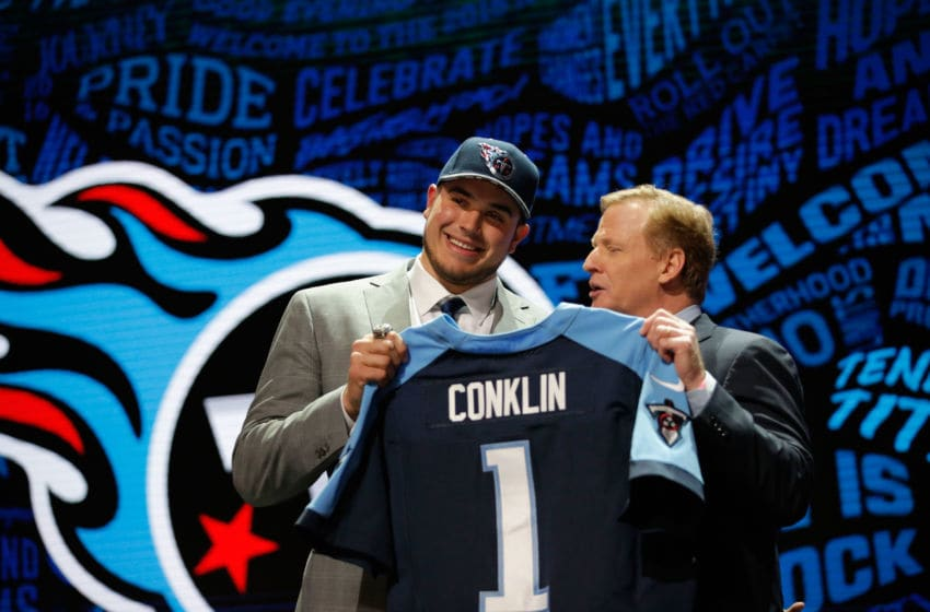 CHICAGO, IL - APRIL 28: Jack Conklin of Michigan State holds up a jersey with NFL Commissioner Roger Goodell after being picked #8 overall by the Tennessee Titans during the first round of the 2016 NFL Draft at the Auditorium Theatre of Roosevelt University on April 28, 2016 in Chicago, Illinois. (Photo by Jon Durr/Getty Images)