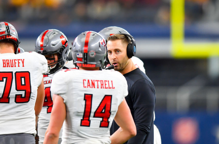 LUBBOCK, TX - NOVEMBER 11 : Head coach Kliff Kingsbury of the Texas Tech Red Raiders talks with Dylan Cantrell #14 of the Texas Tech Red Raiders at a time out during the game against the Baylor Bears on November 11, 2017 at AT&T Stadium in Arlington, Texas. Texas Tech defeated Baylor 38-24. (Photo by John Weast/Getty Images)