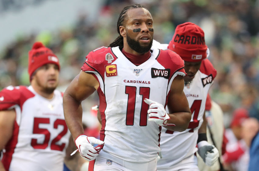 SEATTLE, WASHINGTON - DECEMBER 22: Larry Fitzgerald #11 of the Arizona Cardinals jogs off the field for halftime against the Seattle Seahawks during their game at CenturyLink Field on December 22, 2019 in Seattle, Washington. (Photo by Abbie Parr/Getty Images)
