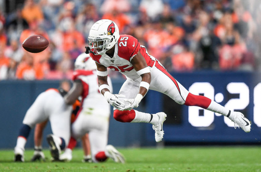 DENVER, CO - AUGUST 29: Chris Jones #25 of the Arizona Cardinals dives for a tipped ball in the first quarter against the Denver Broncos during a preseason National Football League game at Broncos Stadium at Mile High on August 29, 2019 in Denver, Colorado. (Photo by Dustin Bradford/Getty Images)