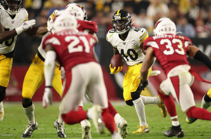 GLENDALE, ARIZONA - DECEMBER 08: Running back Kerrith Whyte #40 of the Pittsburgh Steelers rushes the football against the Arizona Cardinals during the second half of the NFL game at State Farm Stadium on December 08, 2019 in Glendale, Arizona. The Steelers defeated the Cardinals 23-17. (Photo by Christian Petersen/Getty Images)