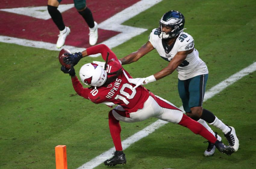 Arizona Cardinals wide receiver DeAndre Hopkins (10) scores a touchdown after a catch while defended by Philadelphia Eagles cornerback Michael Jacquet (38) during the fourth quarter Dec. 20, 2020. Eagles Vs Cardinals