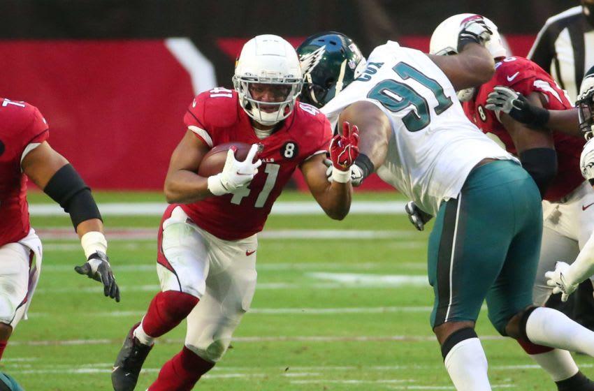 Arizona Cardinals running back Kenyan Drake (41) runs against Philadelphia Eagles defensive tackle Fletcher Cox (91) during the third quarter Dec. 20, 2020. Eagles Vs Cardinals