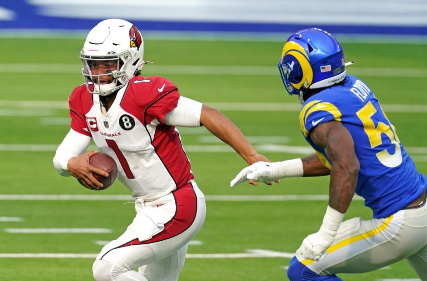 Jan 3, 2021; Inglewood, California, USA; Arizona Cardinals quarterback Kyler Murray (1) runs with the ball as Los Angeles Rams outside linebacker Leonard Floyd (54) defends during the first half at SoFi Stadium. Mandatory Credit: Kirby Lee-USA TODAY Sports