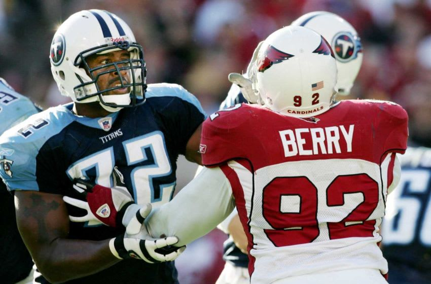No. 17-Brad Hopkins: Tennessee Titans offensive tackle Hopkins (72) blocks Arizona Cardinals defensive end Bertrand Berry during their game at Sun Devil Stadium Oct. 23, 2005. Title 102305 Titans V Cardinals