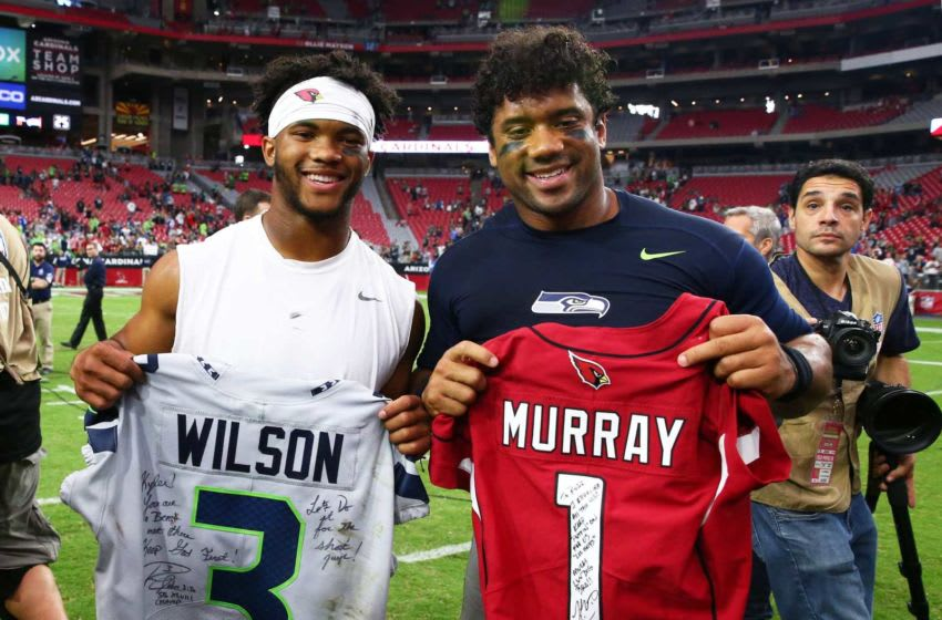 Arizona Cardinals quarterback Kyler Murray hugs Seattle quarterback Russell Wilson swap jerseys after the Seahawks won 27-10 during a game on Sep. 29, 2019 in Glendale, Ariz. Seattle Seahawks Vs Arizona Cardinals 2019
