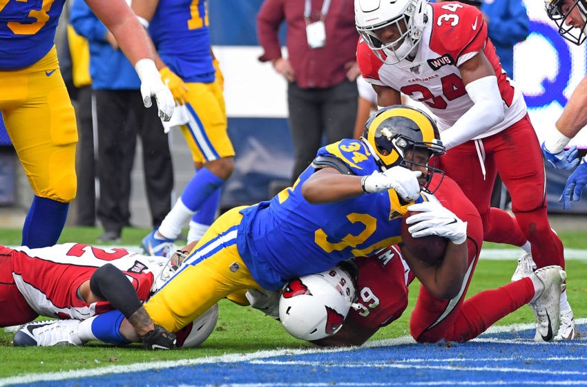 LOS ANGELES, CA - DECEMBER 29: Running back Malcolm Brown #34 of the Los Angeles Rams rushes past strong safety Budda Baker #32 and linebacker Micah Kiser #59 of the Los Angeles Rams for a touchdown in the first half of the game at the Los Angeles Memorial Coliseum on December 29, 2019 in Los Angeles, California. (Photo by Jayne Kamin-Oncea/Getty Images)
