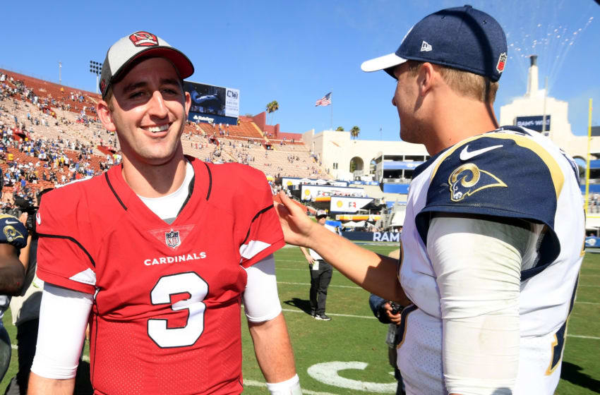 LOS ANGELES, CA - SEPTEMBER 16: Josh Rosen #3 of the Arizona Cardinals and Jared Goff #16 of the Los Angeles Rams enjoy a laugh after a handshake at the end of the game during a 34-0 Rams win at Los Angeles Memorial Coliseum on September 16, 2018 in Los Angeles, California. (Photo by Harry How/Getty Images)