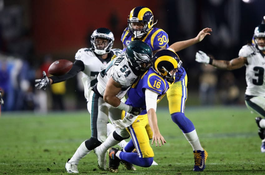 LOS ANGELES, CA - DECEMBER 16: Kamu Grugier-Hill #54 of the Philadelphia Eagles hits Jared Goff #16 causing an interception as Todd Gurley #30 of the Los Angeles Rams blocks during the second half of a game at Los Angeles Memorial Coliseum on December 16, 2018 in Los Angeles, California. (Photo by Sean M. Haffey/Getty Images)