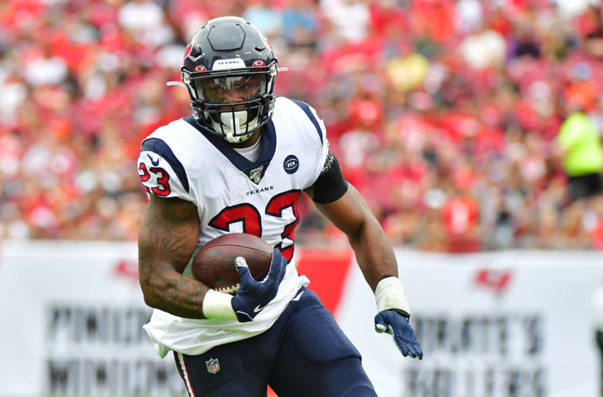 TAMPA, FLORIDA - DECEMBER 21: Carlos Hyde #23 of the Houston Texans runs for a first down during the second quarter of a football game against the Tampa Bay Buccaneers at Raymond James Stadium on December 21, 2019 in Tampa, Florida. (Photo by Julio Aguilar/Getty Images)