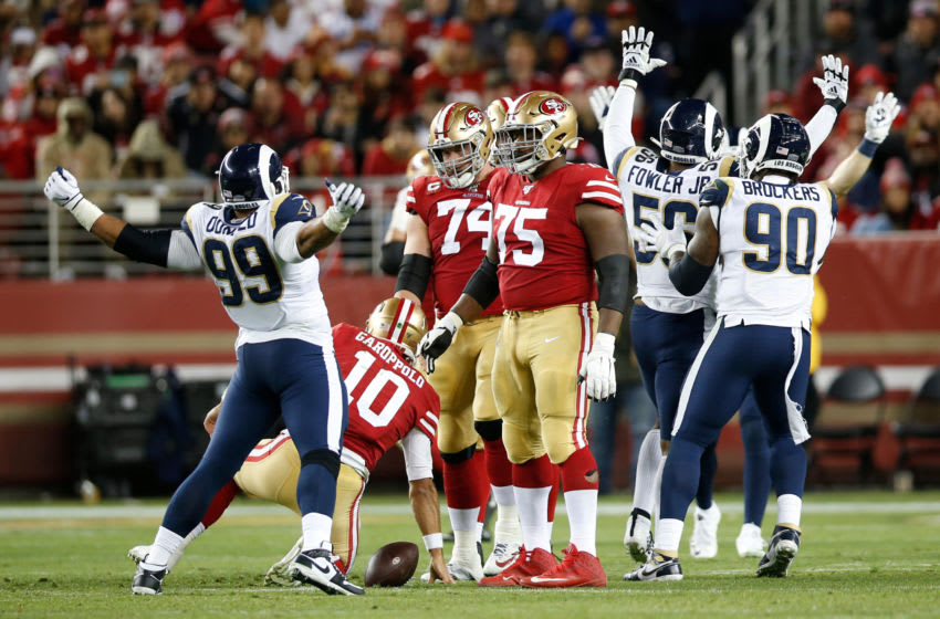 SANTA CLARA, CA - DECEMBER 21: Aaron Donald #99 of the Los Angeles Rams celebrates after sacking Jimmy Garoppolo #10 of the San Francisco 49ers during the game at Levi's Stadium on December 21, 2019 in Santa Clara, California. The 49ers defeated the Rams 34-31. (Photo by Michael Zagaris/San Francisco 49ers/Getty Images)