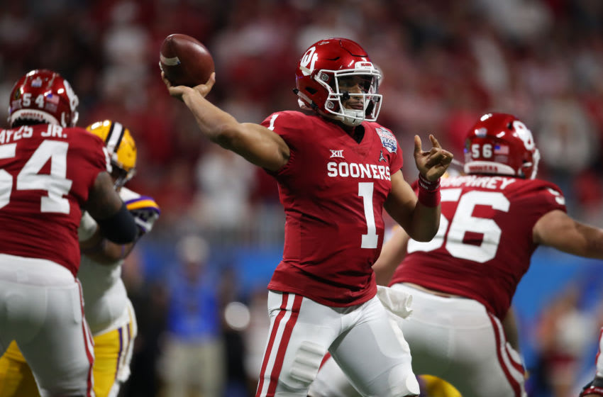 ATLANTA, GEORGIA - DECEMBER 28: Jalen Hurts #1 of the Oklahoma Sooners plays against the LSU Tigers during the College Football Playoff Semifinal in the Chick-fil-A Peach Bowl at Mercedes-Benz Stadium on December 28, 2019 in Atlanta, Georgia. (Photo by Gregory Shamus/Getty Images)