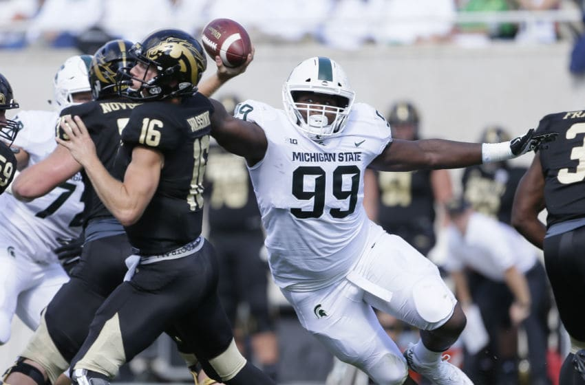 EAST LANSING, MI - SEPTEMBER 09: Defensive tackle Raequan Williams #99 of the Michigan State Spartans closes in on quarterback Jon Wassink #16 of the Western Michigan Broncos during the first half at Spartan Stadium on September 9, 2017 in East Lansing, Michigan. Michigan State defeated Western Michigan 24-14. (Photo by Duane Burleson/Getty Images)